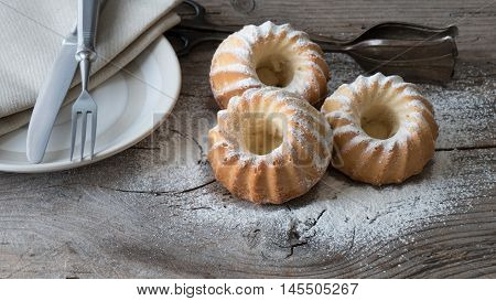 Closeup of three sweet cakes on wooden table