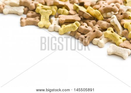 Dog food shaped like bones isolated on white background.