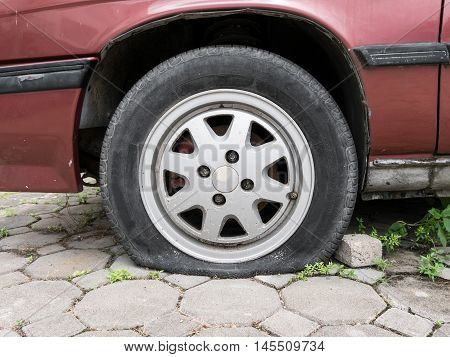 Close up Flat tire and old car