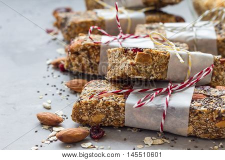 Homemade granola energy bars with figs oatmeal almond dry cranberry chia and sunflower seeds healthy snack copy space
