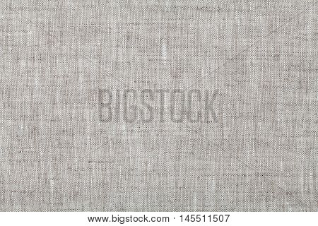 Fabric background in neutral grey color, linen texture, top view.