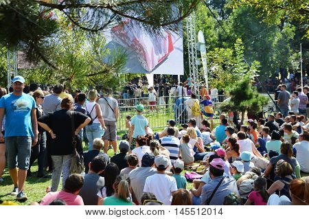 CLUJ-NAPOCA ROMANIA - SEPTEMBER 3 2016: People watching the race on the big screen at the Red Bull Soapbox Race in the park