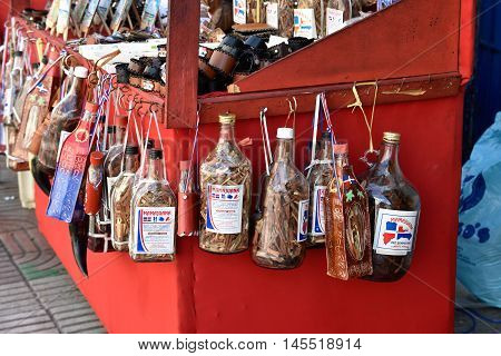 SANTO DOMINGO, DOMINICAN REPUBLIC - JANUARY 24: Dominican alcoholic liquor, called Mamajuana, sold as souvenirs on January 24 2016 in Conde street, Santo Domingo, Dominican Republic.