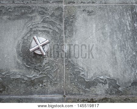 Water valve Mounted on the wall of the old cement, With place your text