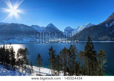 Winter landscape with mountain lake. Alps Achensee Austria.