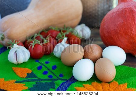 Bright Thanksgiving harvest composition of vegetables pumkin calabash tomatoes garlic eggs