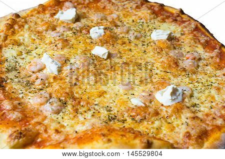 Pizza with shrimp cream fraiche cheese tomatoes and Pesto Sauce.