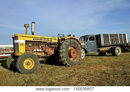 ROLLAG, MINNESOTA, Sept 1, 2016: An old Minneapolis Moline G705 tractor and ton truck are displayed at the West Central Steam Threshers Reunion(WCSTR) where 1000s attend each Labor Day weekend in Rollag, MN each year.