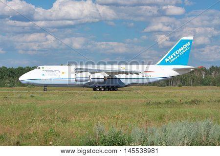 Kiev Region Ukraine - July 20 2012: Antonov Design Bureau An-124 Ruslan cargo plane is taking off for another cargo delivery flight