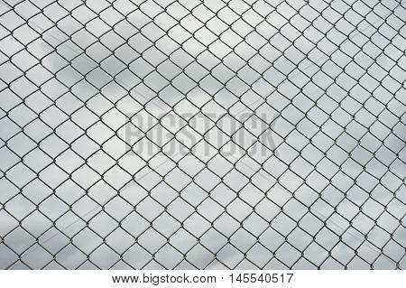 Rusty Steel Wire Mesh Fence , Cloud In Background