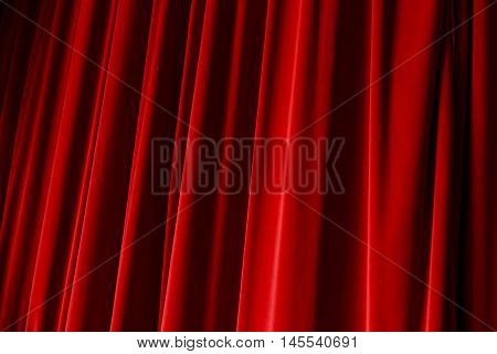 Red drop curtain hanging on a stage