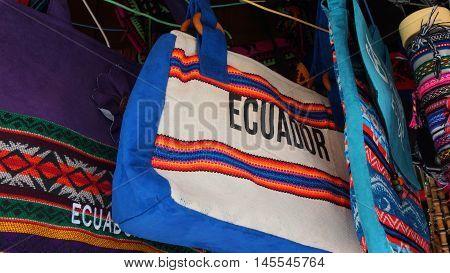 Banos de Agua Santa, Tungurahua / Ecuador - September 2 2016: Indian handmade bag sale at a craft store in the Pasaje Artesanal in the downtown of the city of Banos
