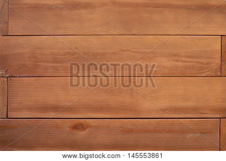 Trimmed wooden baseboard paneling background with horizontal strips