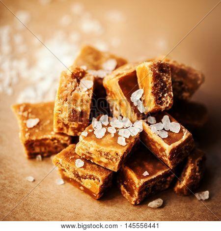 Caramel candies over dark background.Golden Butterscotch toffee caramel