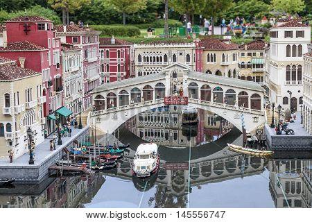 GUNZBURG GERMANY - AUG 18 2016: Mini Venice with the Rialto bridge at the Legoland Deutschland theme park in Gunzburg Germany