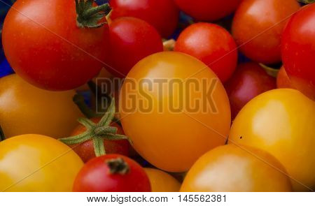 some red and orange small cherry tomatoes