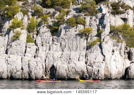 Two kayaks in front of the steep cliffs in the Calanques of Cassis (Provence France)