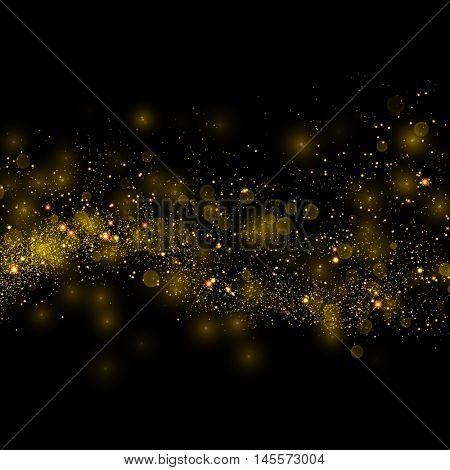 Gold glittering star dust trail sparkling particles on black background. Magical glowing space comet tail. Vector glamour fashion illustration