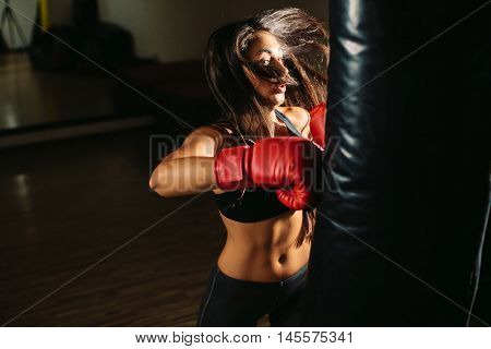 sexy fighter girl punching actively. motion long hair poster
