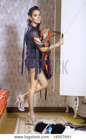 Beautiful Woman Near Wardrobe