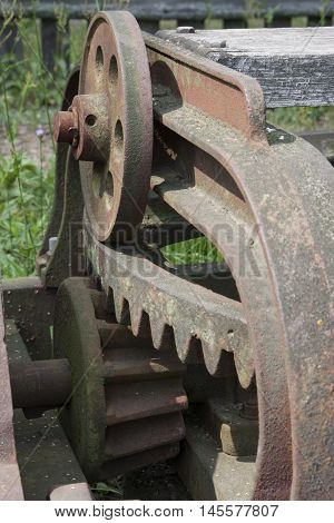 old rusty agricultural machine gears - detail closeup