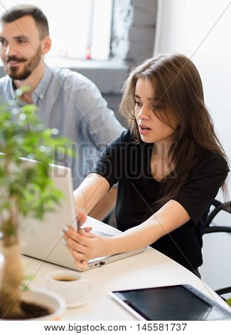 Picture of beautiful businesswoman working o laptop computer in office. Real executive worker typing on keyboard. Business project or strategy concept.