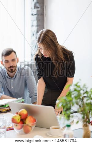 Real executive worker typing on keyboard. Business project or strategy concept. Picture of beautiful businesswoman working o laptop computer in office.