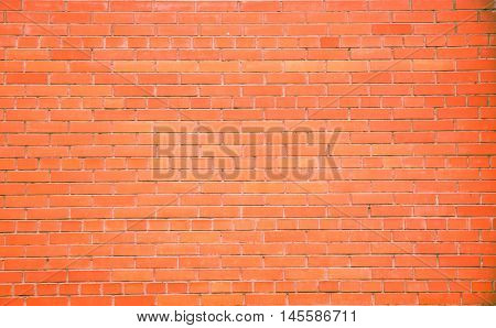 bright brick wall as the background of the small bricks