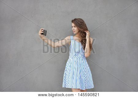Closeup Portrait Of Young Happy Smiling Beautiful Woman In Light Dress With Long Brunette Curly Hair