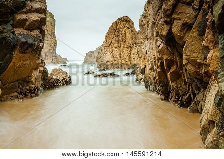 Isolated beach Ursa on Atlantic coast near the Cape Roca, Sintra, Portugal