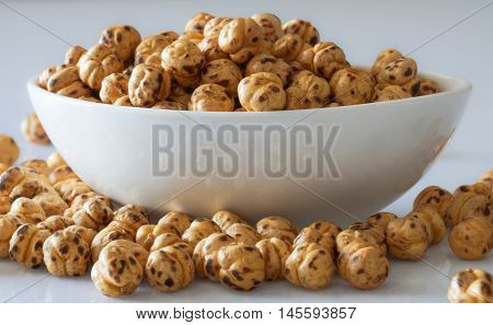 Roasted chick peas in and out of a white bowl