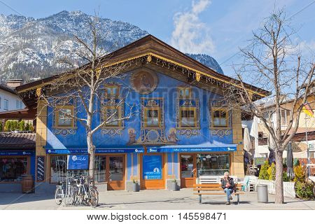GARMISCH-PARTENKIRCHEN GERMANY - APRIL 03 2015: Garmisch-Partenkirchen is a mountain resort town in Bavaria southern Germany.Garmisch-Partenkirchen is playing host to the leaders of the world's largest economic powers G7