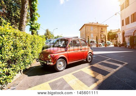 Montepulciano, Italy - May 30, 2016: Red Fiat Nuova 500 stand on the parking in Montepulciano town in Tuscany in Italy. Fiat 500 is a car produced by italian manufacture between 1957 and 1975