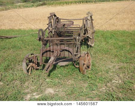 Old abandoned horse drawn potato digger used in the early farming days.