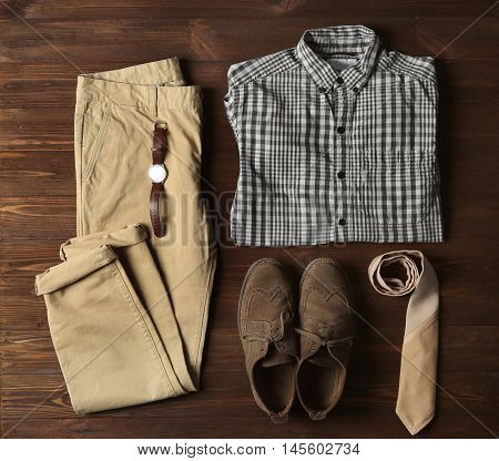 Mens clothes and accessories on wooden background