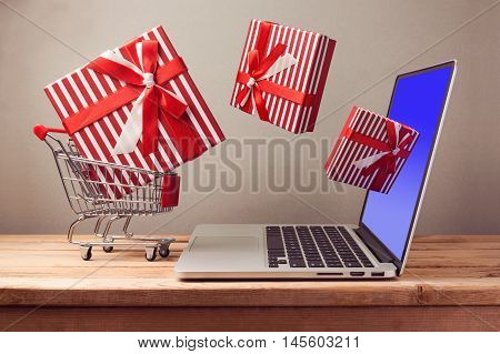 Shopping online concept with laptop computer and git box