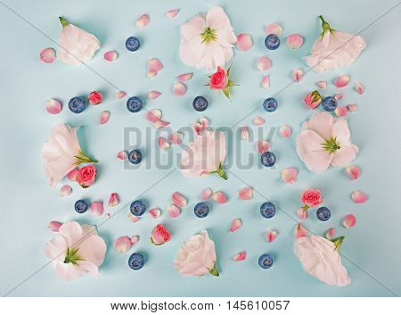 Tender pattern made of blueberries and flowers