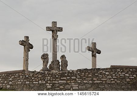 Crosses on the hill in cloudy weather