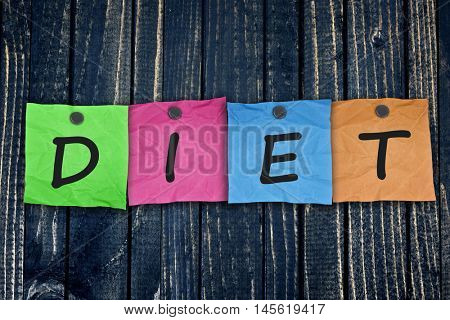 Diet message post on wooden wall close-up