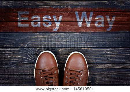Easy Way message and sport shoes on wooden floor