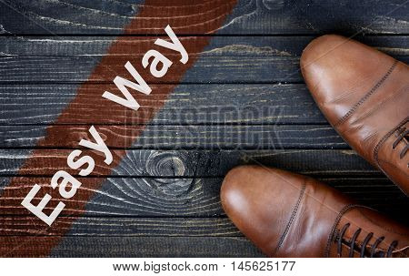 Easy way message and business shoes on wooden floor