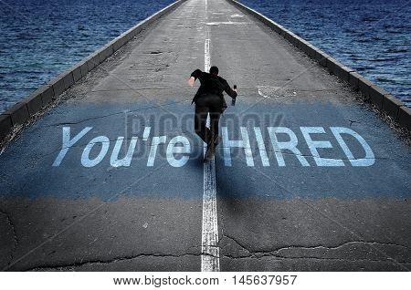 You're hired message on road and business man