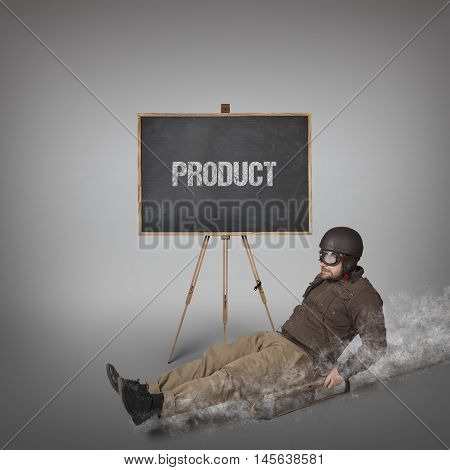 Product text on blackboard with businessman sliding with a sledge