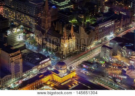 Melbourne Australia - August 27 2016: Aerial view of Flinders Street Station and St. Paul's Cathedral at night.