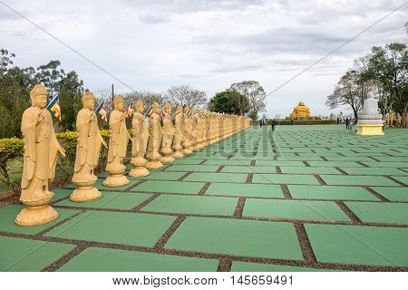 Several Buddha Statues In Perspective At The Buddhist Temple