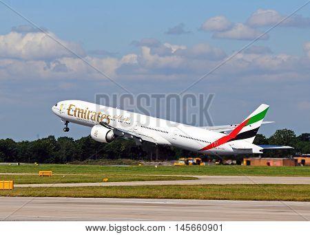 MANCHESTER, UNITED KINGDOM - AUGUST 17, 2014 - Emirates Boeing 777-300 taking off from Manchester Airport Manchester England UK Western Europe, August 17, 2014.