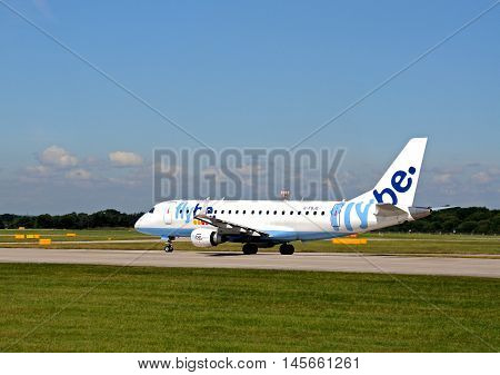 MANCHESTER, UNITED KINGDOM - AUGUST 17, 2014 - Flybe Embraer ERJ-175STD taxiing at Manchester Airport Manchester England UK Western Europe, August 17, 2014.