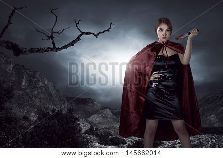 Beautiful Asian Witch Woman Holding Bloody Knife