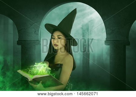 Asian Witch Woman Holding The Book
