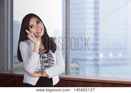 Asian Business Woman Being Call With Smartphone In The Office Room